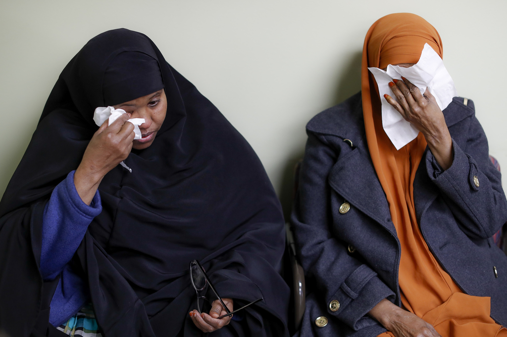 FILE - In this March 16, 2017, file photo, Somali refugees Layla Muali, left, and Hawo Jamile, right, wipe away tears during an interview at the Commu...