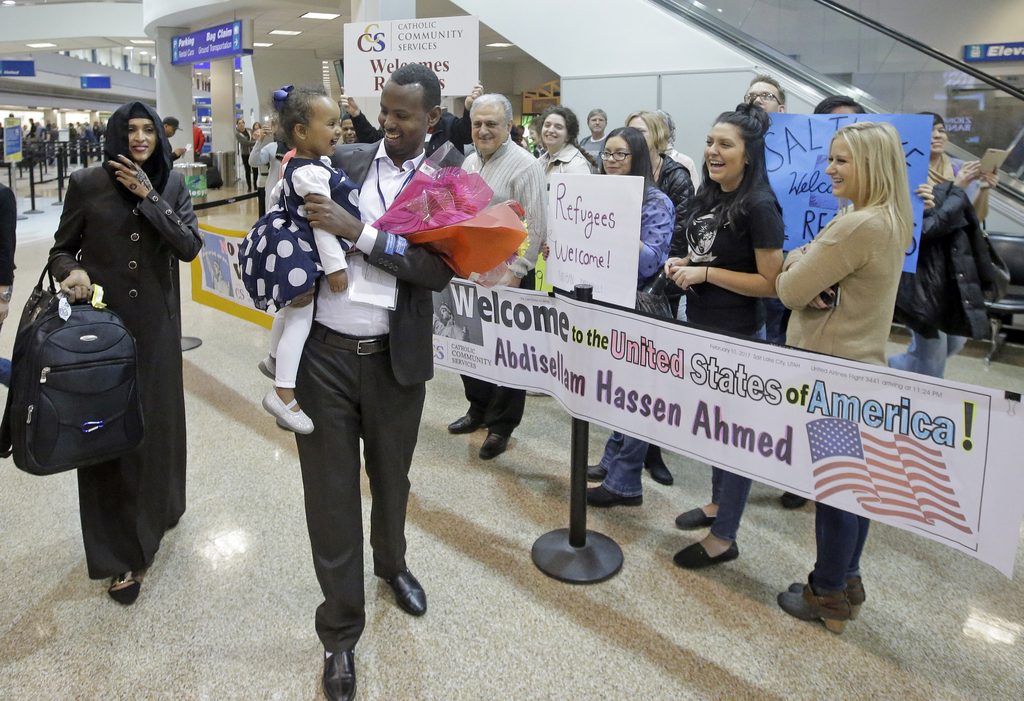 FILE - This Feb. 10, 2017, file photo, Abdisellam Hassen Ahmed, a Somali refugee who had been stuck in limbo after President Donald Trump temporarily ...