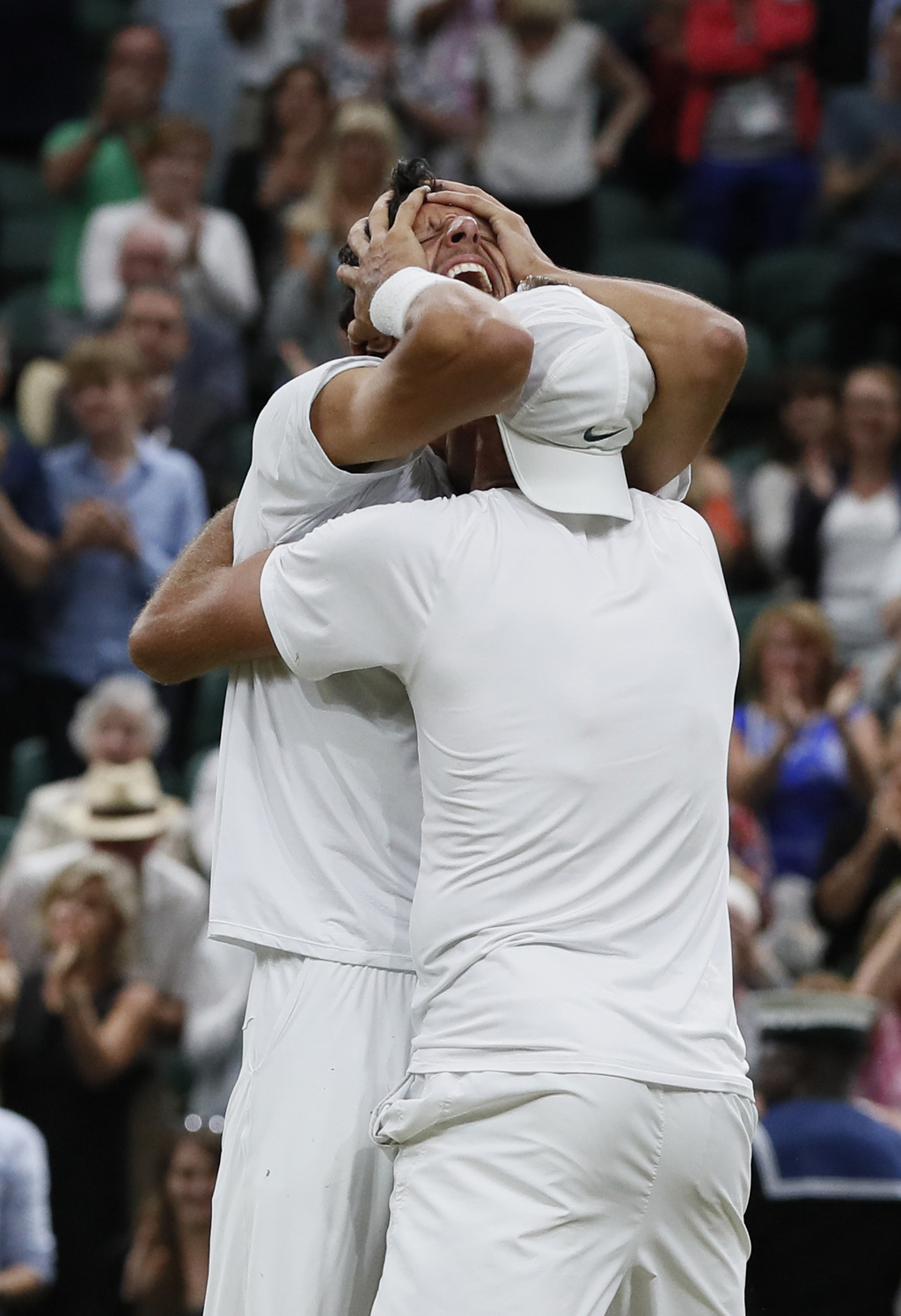 Poland's Lukasz Kubot, right, and Brazil's Marcelo Melo, hug as they celebrate after defeating Austria's Oliver Marach, and Croatia's Mate Pavic in th