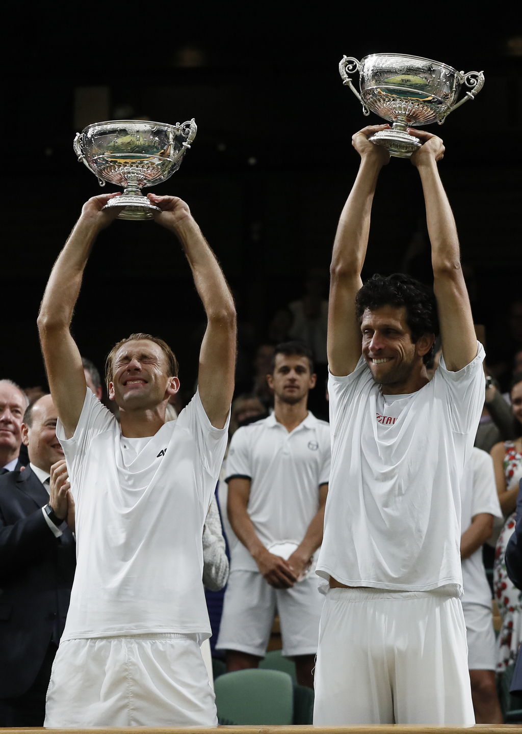 Poland's Lukasz Kubot, left, and Brazil's Marcelo Melo hold up their winners trophies after defeating Austria's Oliver Marach, and Croatia's Mate Pavi