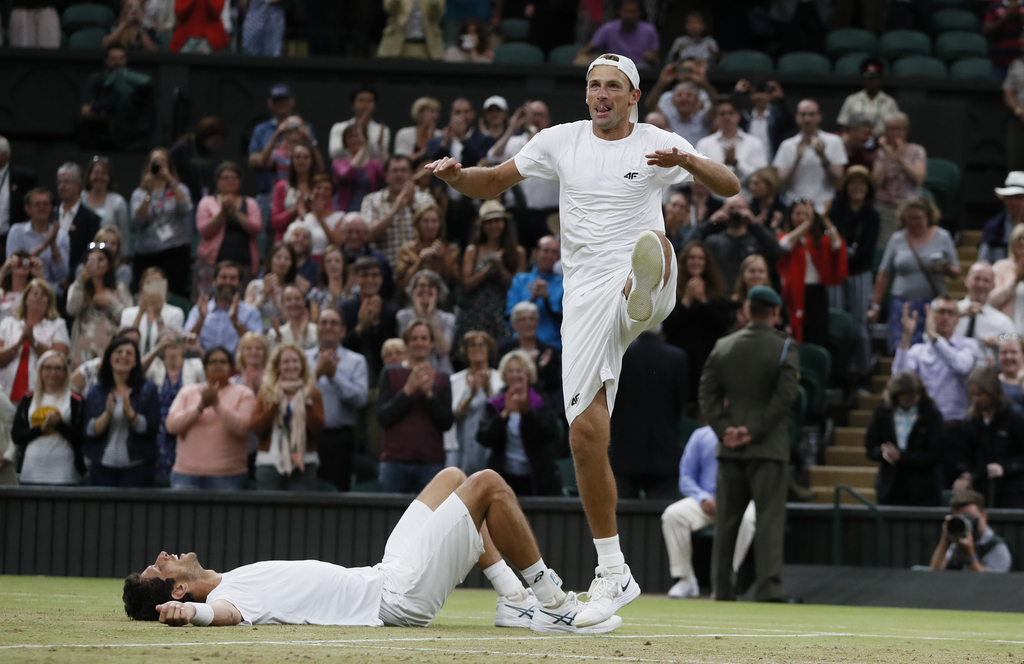 Poland's Lukasz Kubot, right, and Brazil's Marcelo Melo who lies on the floor celebrate after defeating Austria's Oliver Marach, and Croatia's Mate Pa