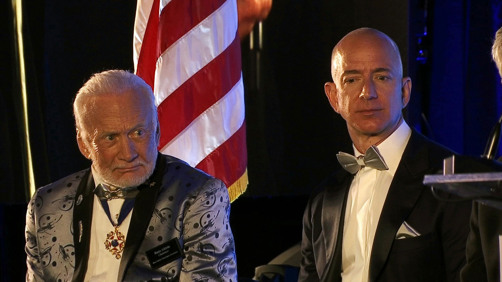 Apollo 11 astronaut Buzz Aldrin, left, and Amazon.com and Blue Origins founder Jeff Bezos attend the commemoration for the upcoming anniversary of the...
