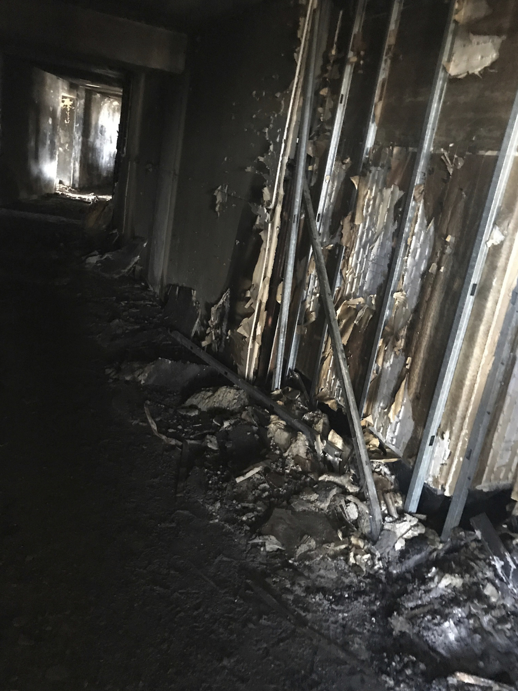 This photo provided by Bruce Campbell, a unit manager in the Marco Polo building in Honolulu, shows the charred interior of the building on Saturday, ...