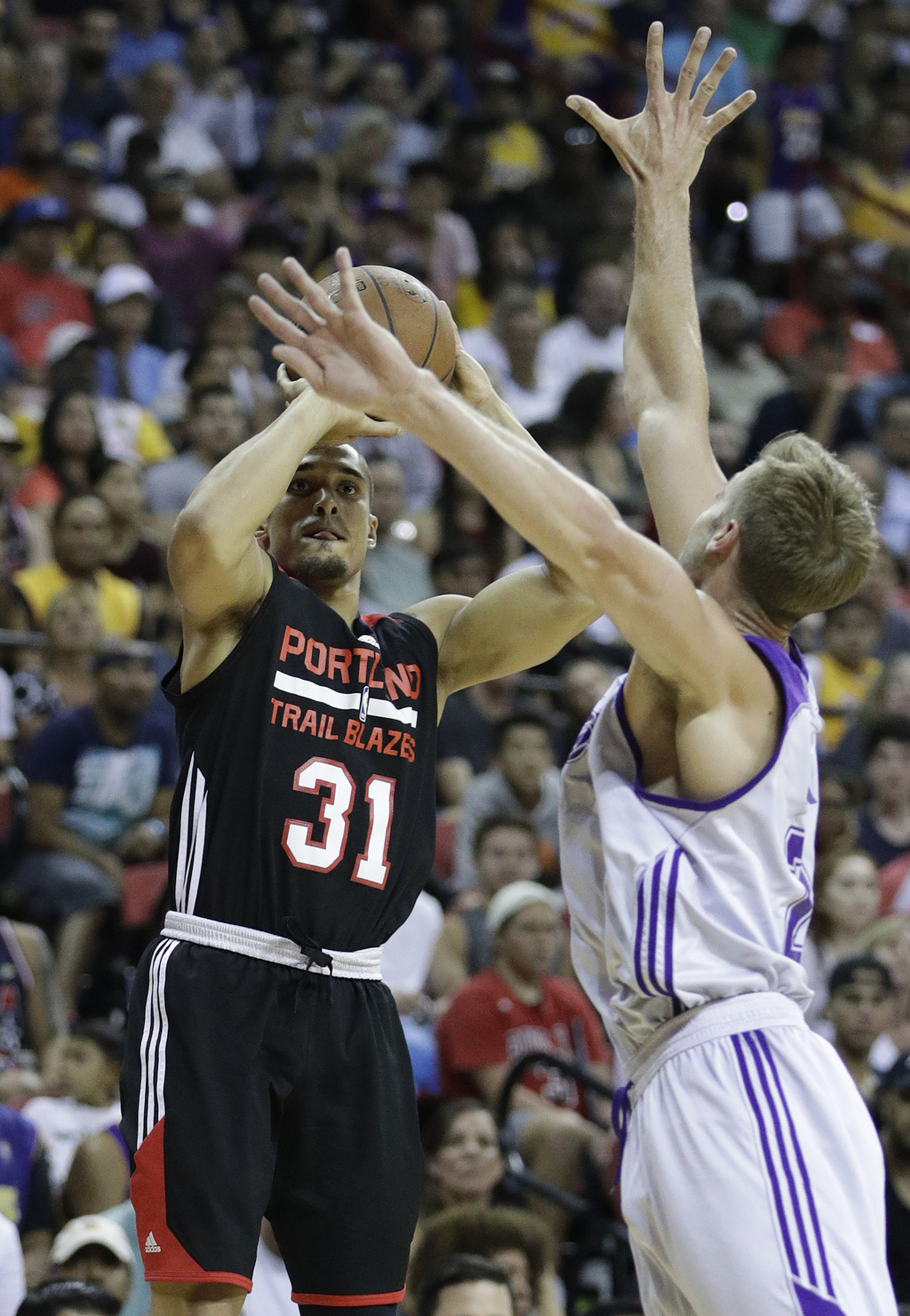 6508b616920 Portland Trail Blazers  Nick Johnson shoots over Los Angeles Lakers  Travis  Wear during the
