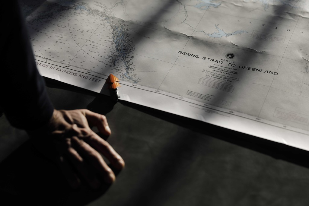 Polar maritime lawyer Scott Joblin, from the Australian National University in Cambria, looks over a map aboard the Finnish icebreaker MSV Nordica as ...
