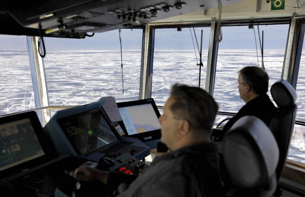 Master Mariner Jyri Viljanen, left, captain of the Finnish icebreaker MSV Nordica and Chief Officer Harri Venalainen, navigate from the bridge through...