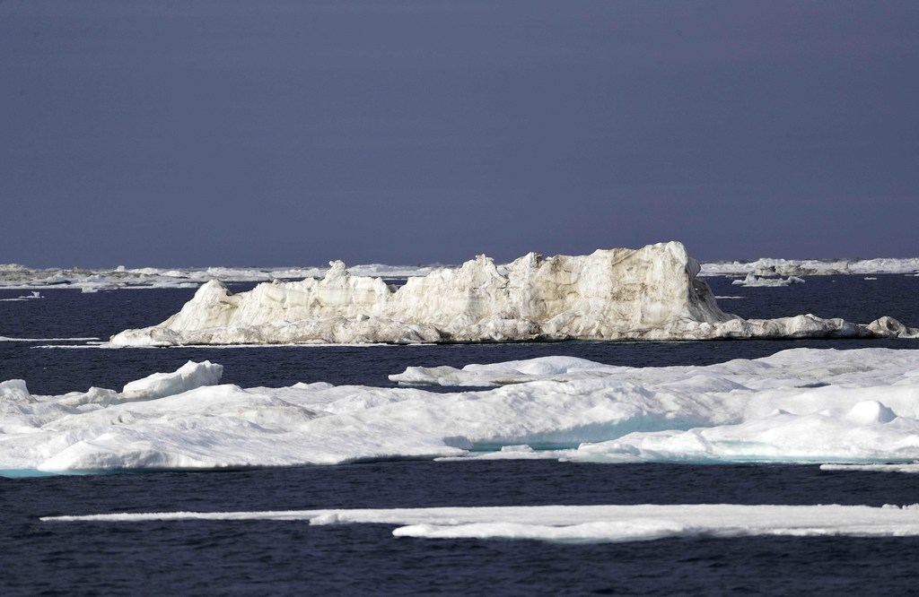 Sea ice floats past the Finnish icebreaker MSV Nordica as the ship sails through the Chukchi Sea off the coast of Alaska, Sunday, July 16, 2017, while...