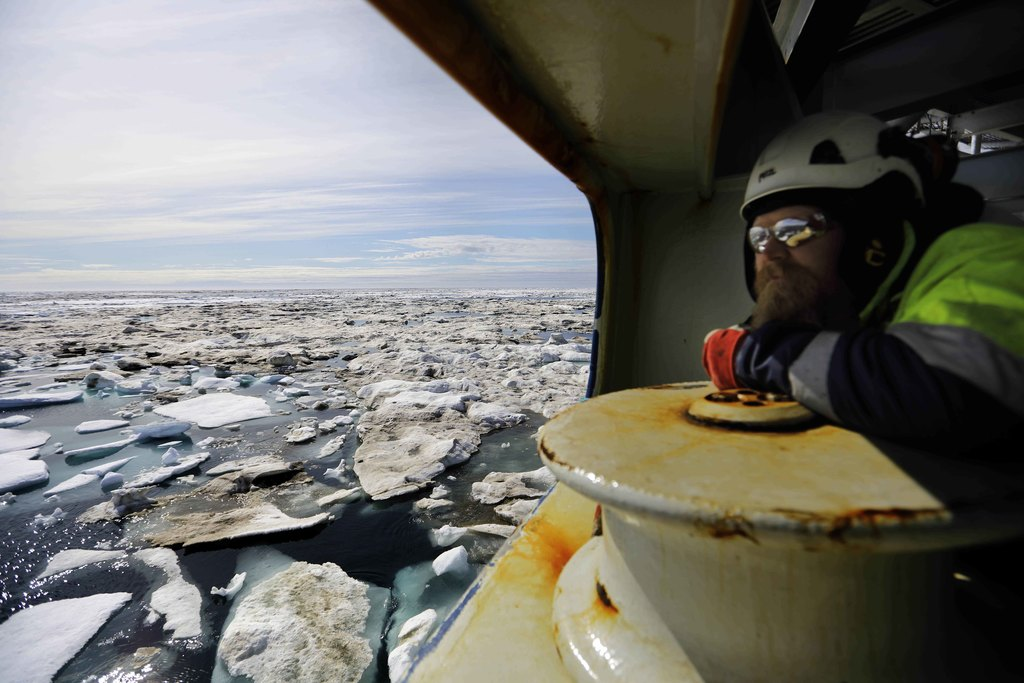 Trainee Jussi Mikkotervo looks out from the bow of the Finnish icebreaker MSV Nordica as it sails through ice floating on the Chukchi Sea off the coas...