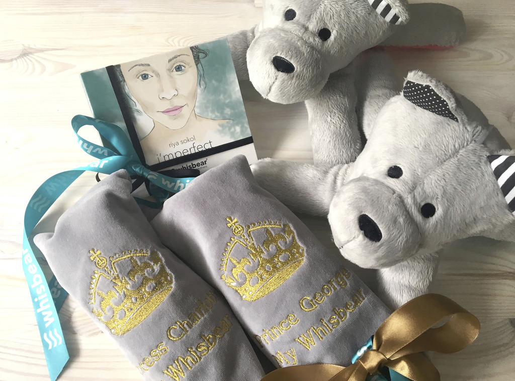 In this July 14, 2017 photo publicly provided by Whisbear The Heart in Warsaw, two bears,  gifts for Prince George and Princess Charlotte, presented t...