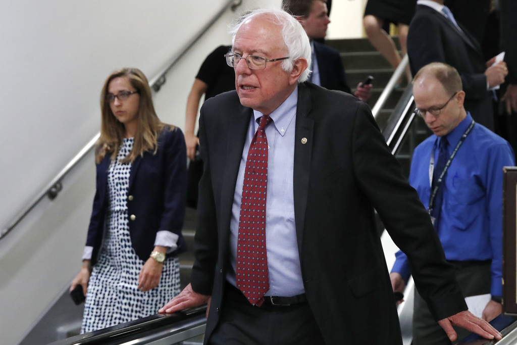FILE - In this July 11, 2017, file photo, Sen. Bernie Sanders, I-Vt., rides an escalator on Capitol Hill in Washington. Americans aren't too thrilled ...