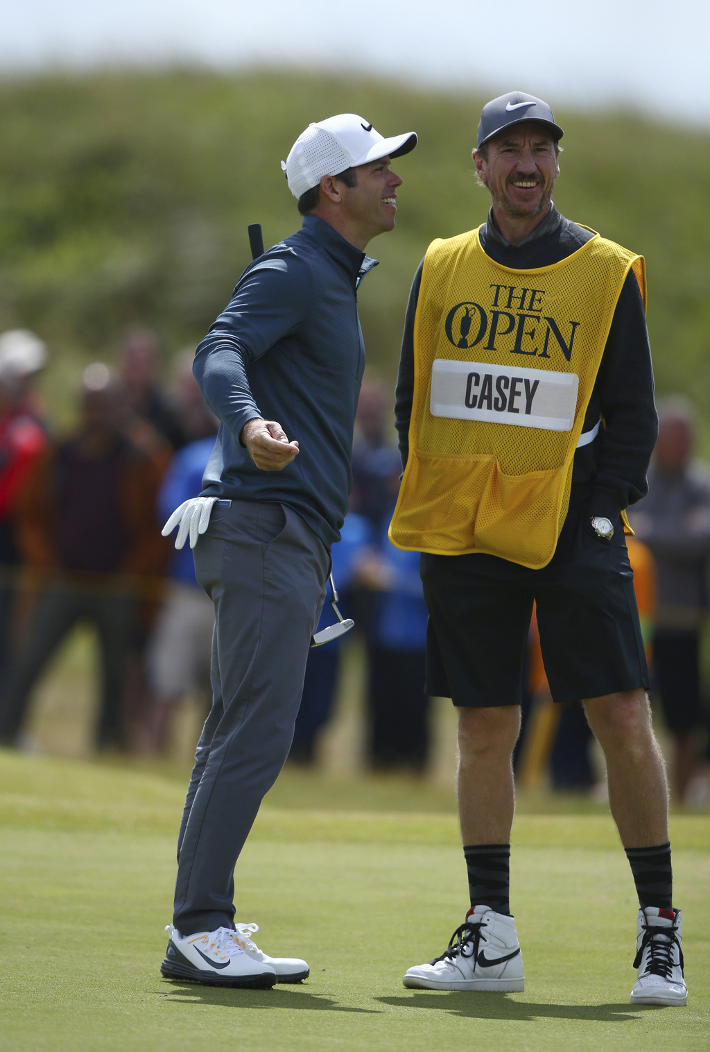England's Paul Casey laughs with his caddie on the 4th green during the first round of the British Open Golf Championship, at Royal Birkdale, Southpor...
