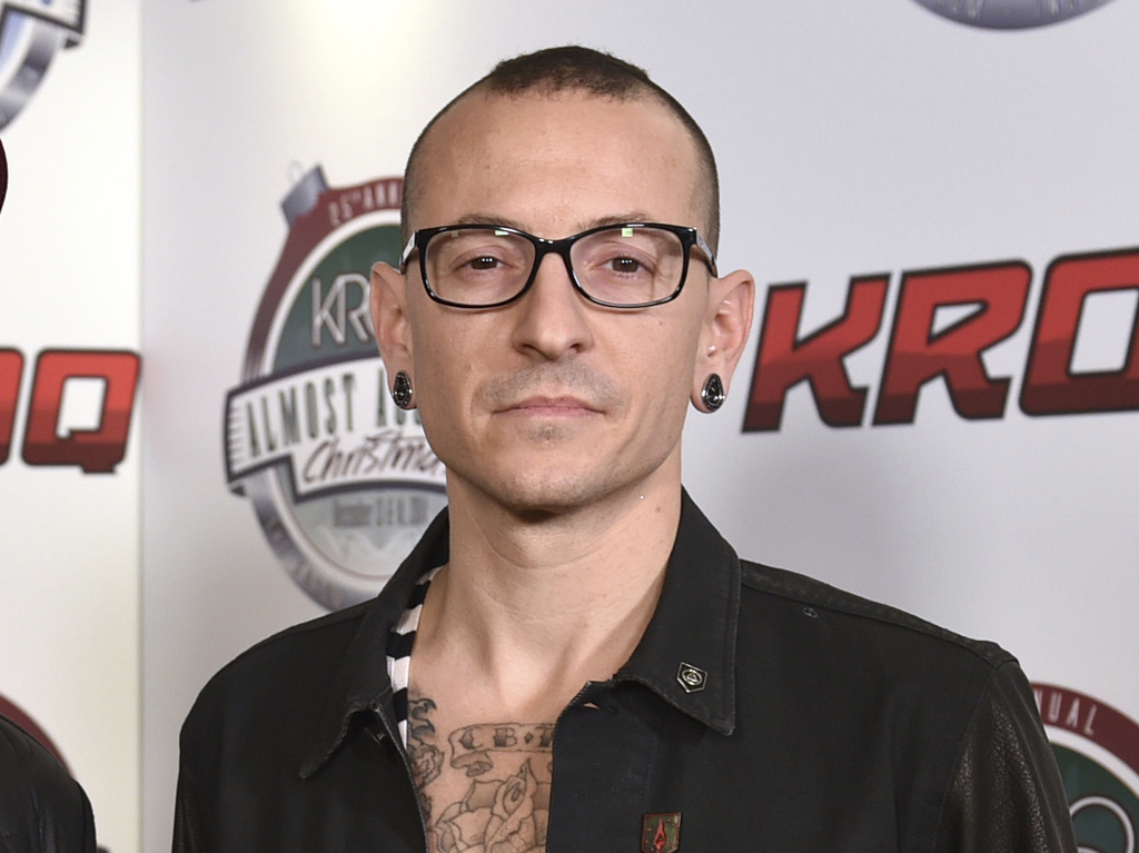 FILE - In this Dec. 13, 2014 file photo, Chester Bennington poses in the press room at the 25th annual KROQ Almost Acoustic Christmas in Inglewood, Ca...