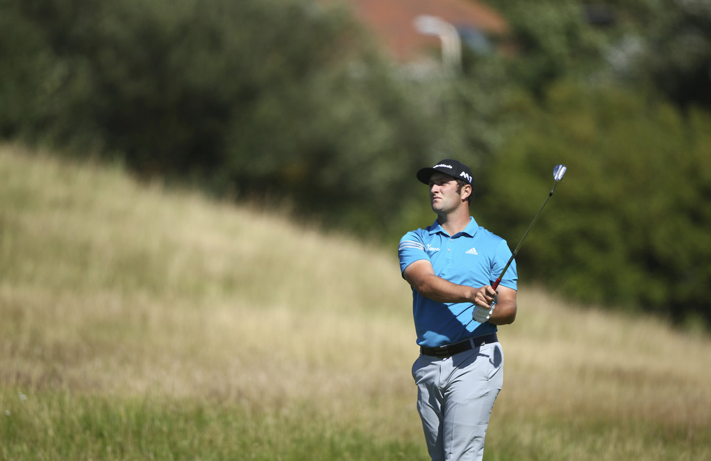 Spain's Jon Rahm plays a shot on the 5th hole during the first round of the British Open Golf Championship, at Royal Birkdale, Southport, England Thur...