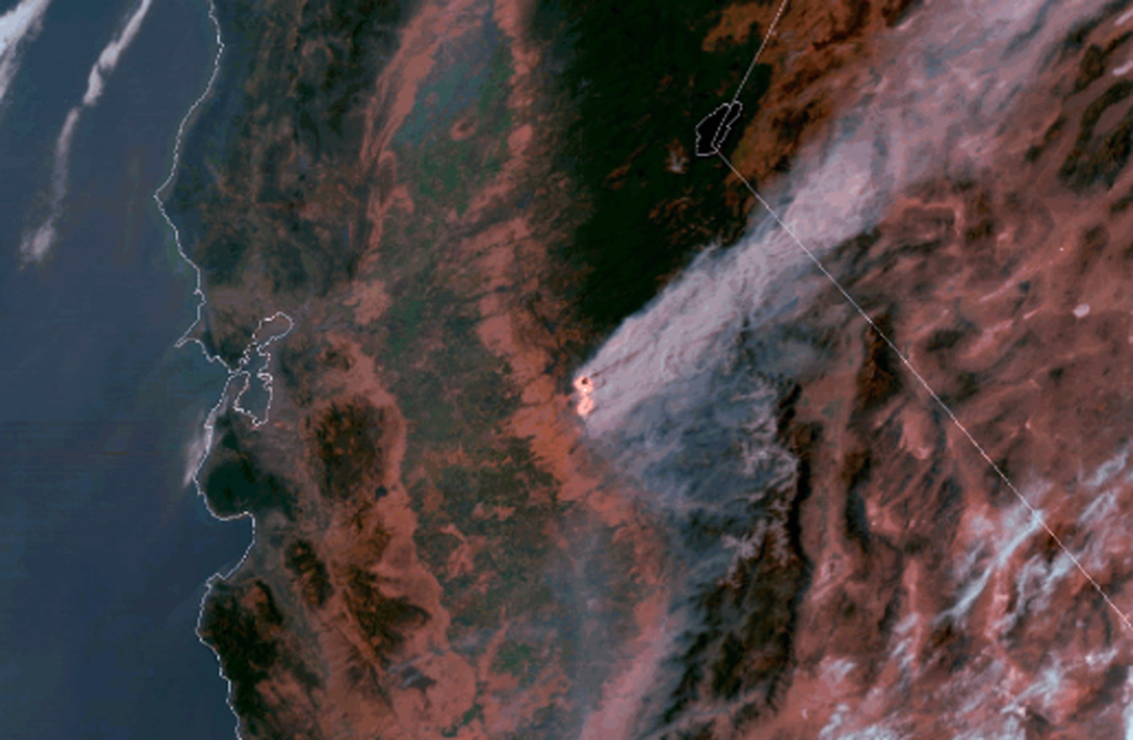 This satellite imagery, posted Wednesday, July 19, 2017 on a National Oceanic and Atmospheric Administration website, shows a large plume of smoke spr...