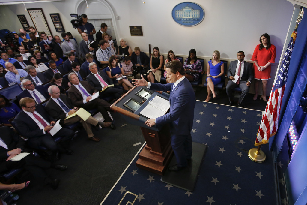 Sarah Huckabee Sanders, right, who has been named White House press secretary listens to incoming White House communications director Anthony Scaramuc...
