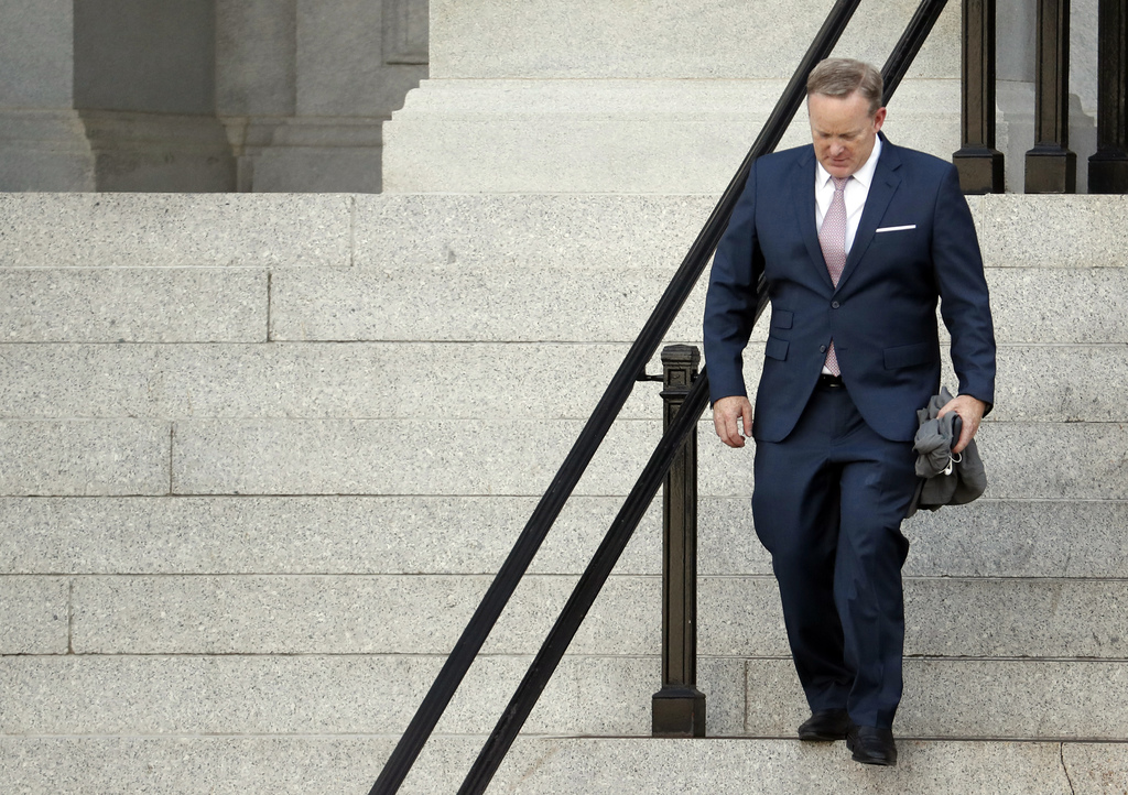 Former White House press secretary Sean Spicer walks down the steps of the Eisenhower Executive Office Building towards the White House, Friday, July ...