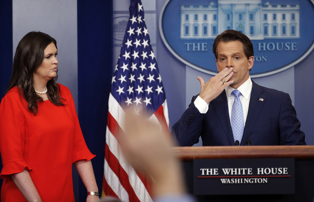 Sarah Huckabee Sanders, left, who has been named White House press secretary, watches as incoming White House communications director Anthony Scaramuc...