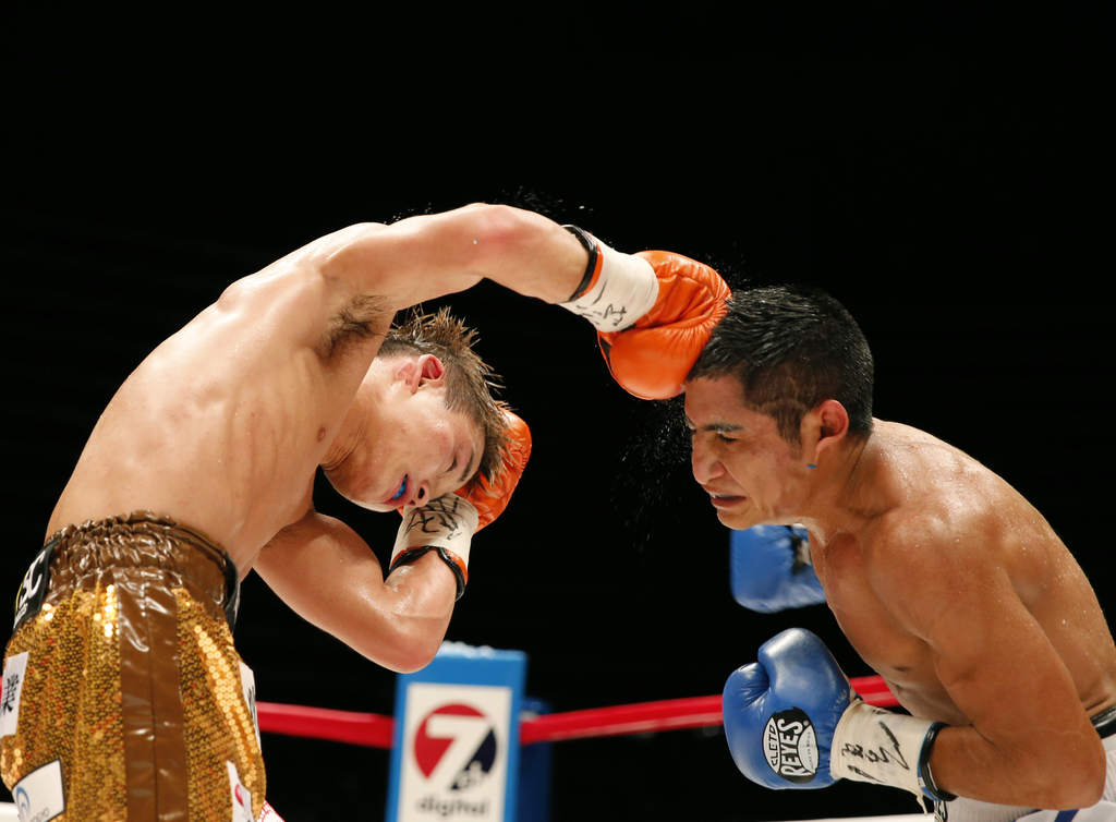 In this Sunday, July 23, 2017, file photo, Japan's Hiroto Kyoguchi, left, sends a right to Mexico's Jose Argued in the seventh round of their IBF worl...