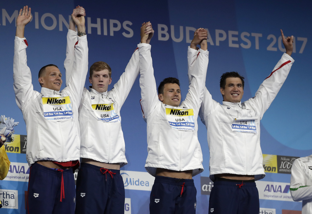 CORRECTS FROM TOWNEY TO TOWNLEY - United States' Caleb Dressel, Townley Haas, Blake Pieroni and Nathan Adrian, from left, celebrate during the ceremon...