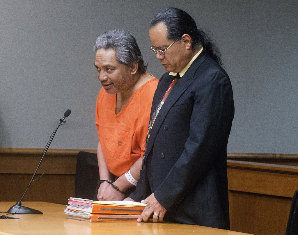 FILE - In this April 5, 2017, file photo, Peter Kema Sr., left, pleads guilty to manslaughter and first-degree hindering prosecution, in Hilo Circuit ...