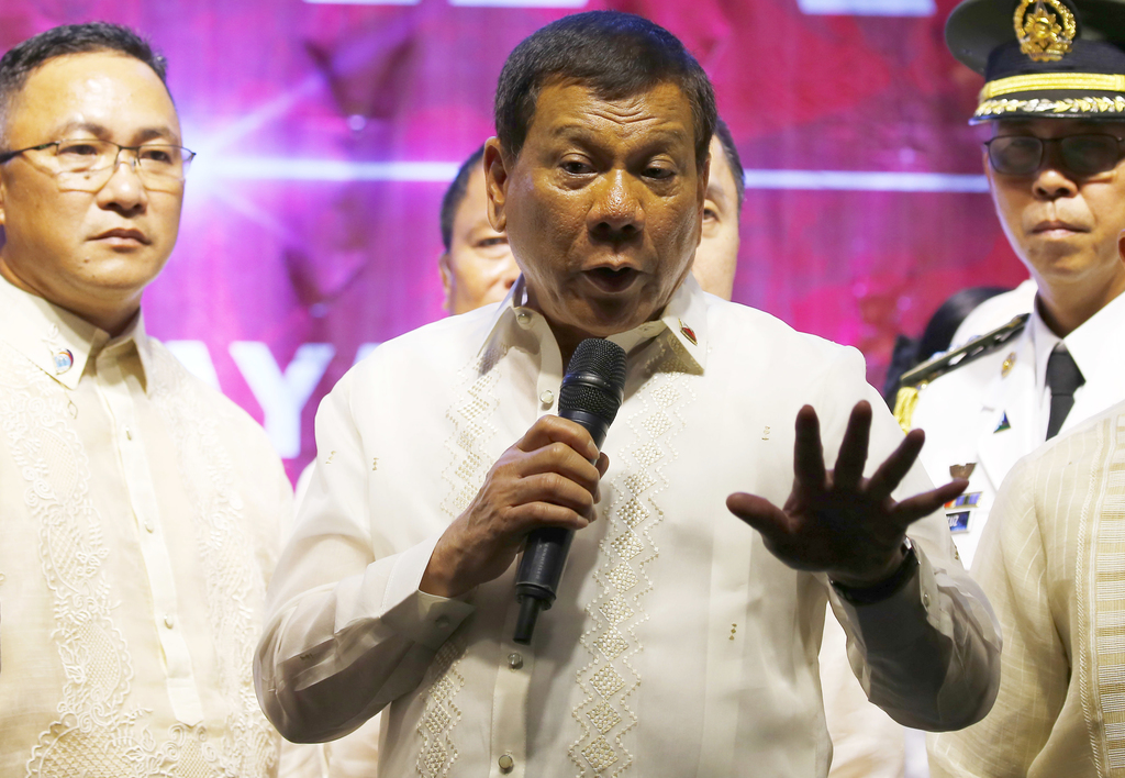 FILE - In this Monday, July 24, 2017, file photo, Philippine President Rodrigo Duterte addresses thousands of protesters following his state of the na...