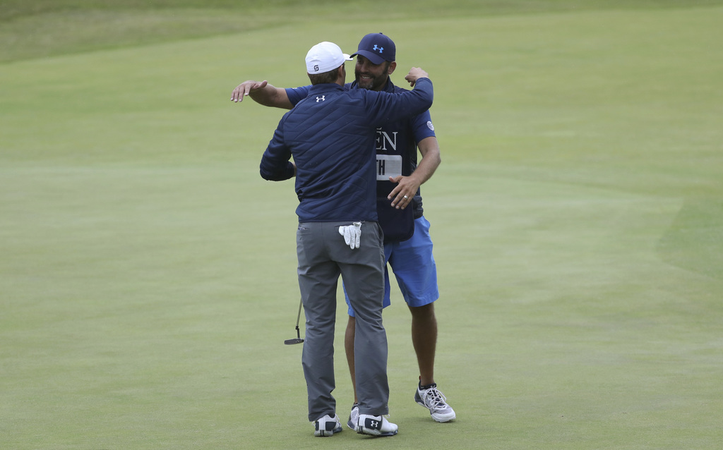 Jordan Spieth of the United States celebrates with his caddie Michael Greiler after winning the British Open Golf Championships at Royal Birkdale, Sou...