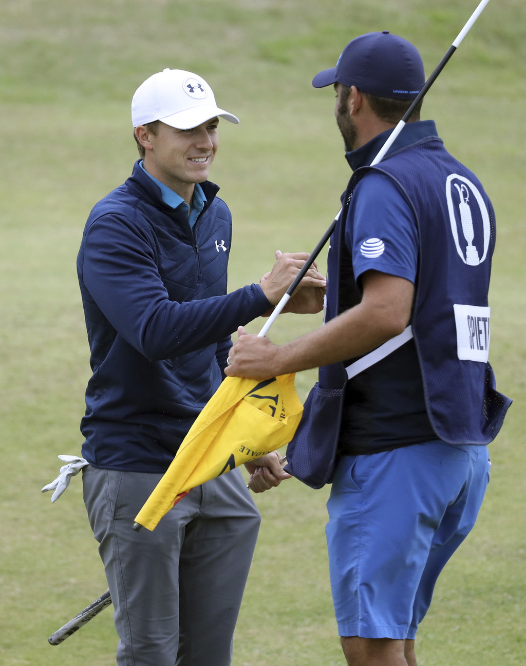 Jordan Spieth of the United States shakes hands with his caddie Michael Greiler after winning the British Open Golf Championships at Royal Birkdale, S...