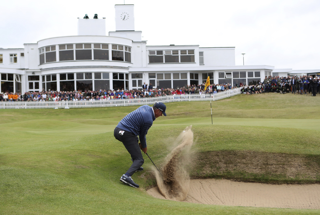 Matt Kuchar of the United States plays out of the bunker on the 18th hole during the final round of the British Open Golf Championship, at Royal Birkd...