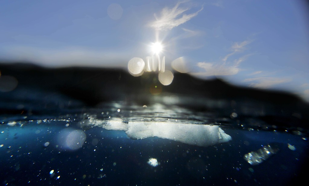 A block of sea ice floats in the Victoria Strait in the wake of the Finnish icebreaker MSV Nordica as it sails the Arctic's Northwest Passage, Friday,...