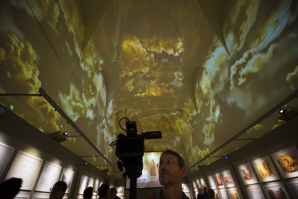 Journalists scan the 'Inferno Room' during a preview of the Franco Zeffirelli International Centre for the Performing Arts in the the late 17th centur...
