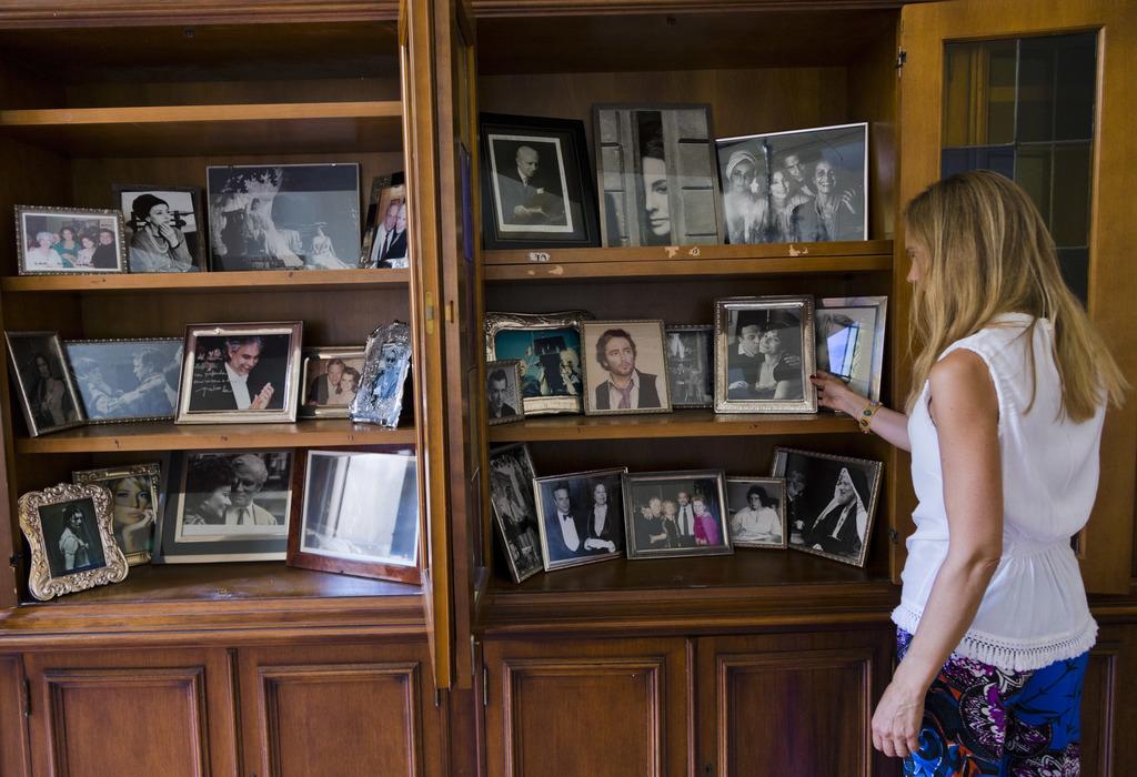 Benedetta Spada with the Zeffirelli Foundation arranges memory photographs of director Franco Zeffirelli in his studio at the Franco Zeffirelli Intern...
