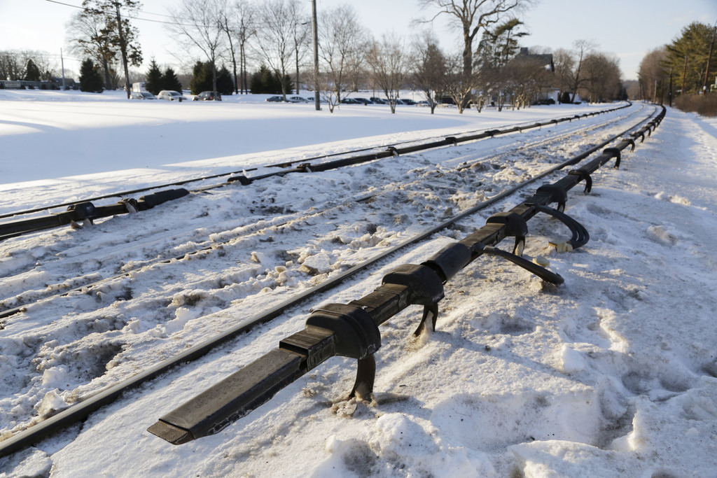 FILE- This Feb. 6, 2015, file photo shows the electrified third rail, bottom, that runs next to Metro-North Railroad tracks in Valhalla, N.Y. Federal ...