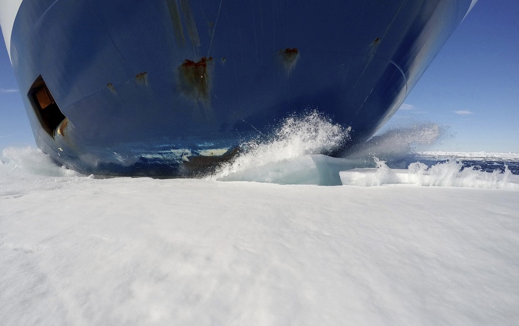 The bow of the Finnish icebreaker MSV Nordica drives through sea ice as it sails the Victoria Strait while traversing the Arctic's Northwest Passage, ...