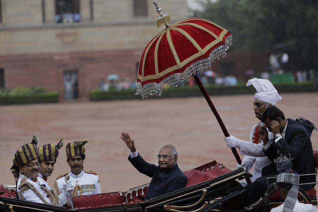 In this Tuesday, July 25, 2017, file photo, India's new President Ram Nath Kovind, waves as he arrives in a traditional horse driven carriage at the P...