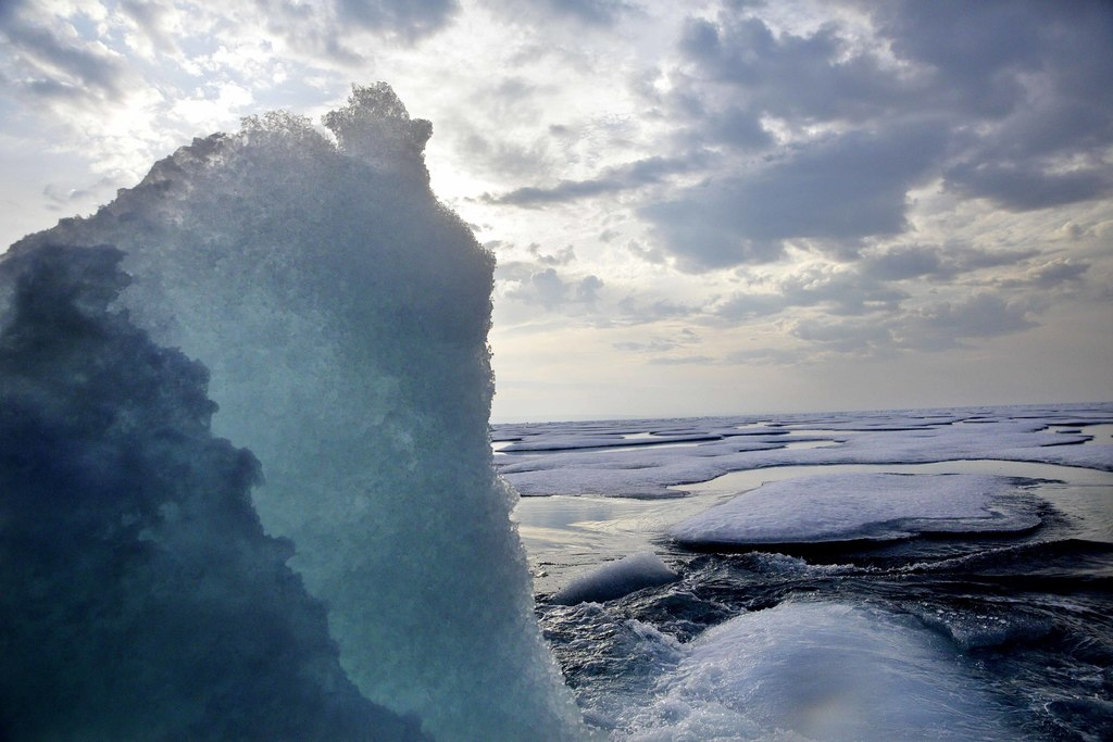 Broken sea ice emerges from under the hull of the Finnish icebreaker MSV Nordica as it sails through the Franklin Strait while traversing the Arctic's...