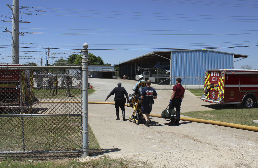 In this photo provide by the Bryan, Texas Fire Department, taken April 29, 2014, Bryan Texas firefighters transport injured worker in a stretcher to t...