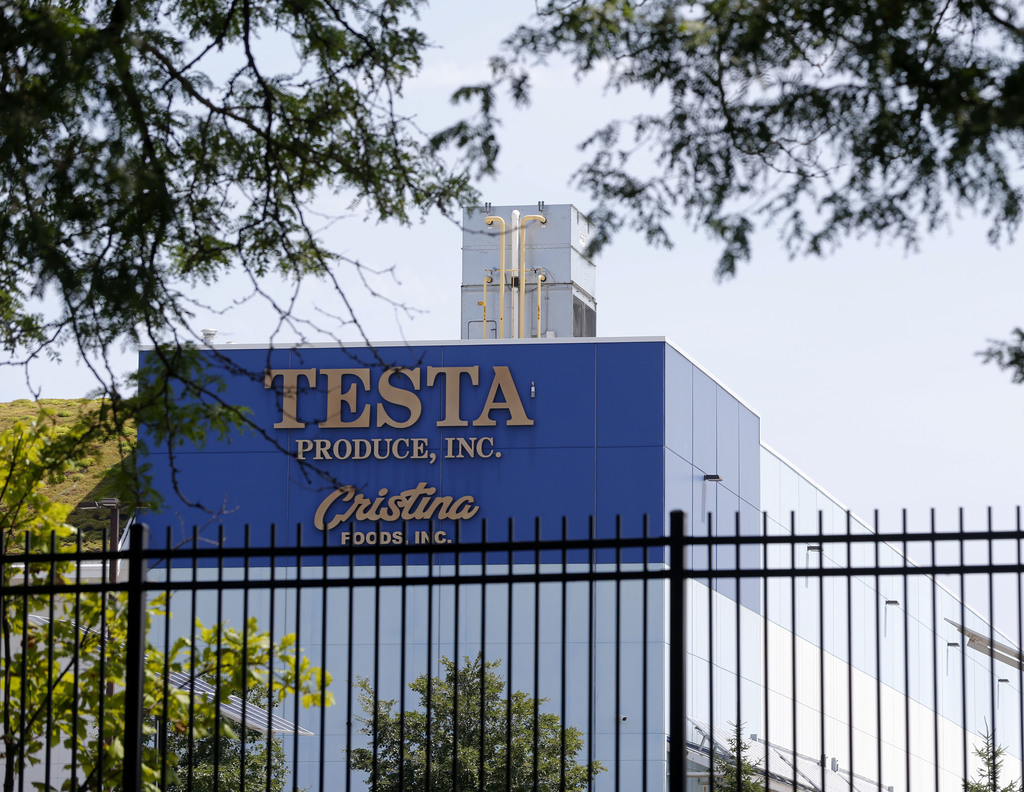 In this photo taken July 20, 2017, the Testa Produce Inc. plant on the South Side of Chicago. Older people are dying on the job at a higher rate than ...