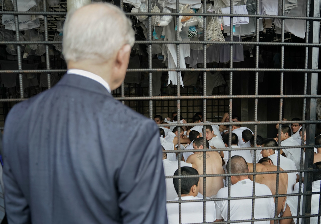 U.S. Attorney General Jeff Sessions stops to look at cell conditions during a tour of local police station and detention center in San Salvador, El Sa...