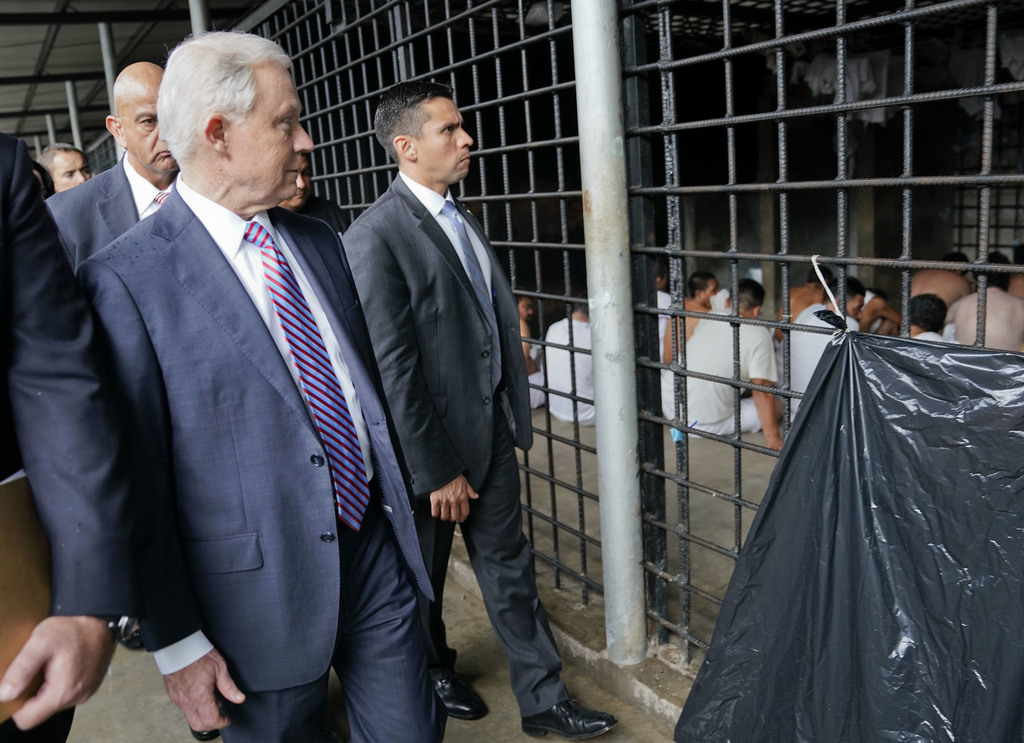 U.S. Attorney General Jeff Sessions looks at a cell during a tour of local police station and detention center in San Salvador, El Salvador, Thursday,...