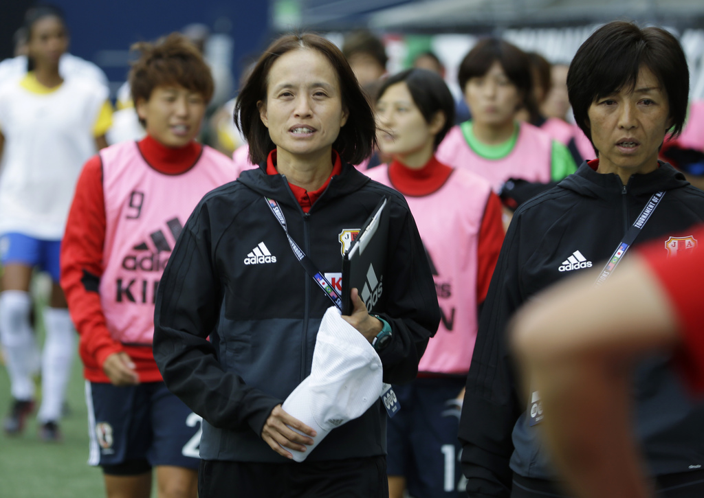 FILE - In this Thursday, July 27, 2017 file photo, Japan coach Asako Takakura, center, walks to the bench with her reserve players before a Tournament...