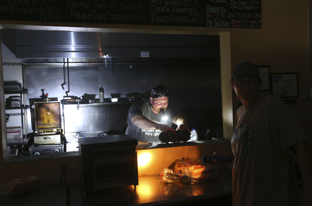 Aaron Howe cooks in the dark kitchen at the Island Convenience Store in Rodanthe on Hatteras Island, N.C.,  on Friday, July 28, 2017.   An estimated 1...
