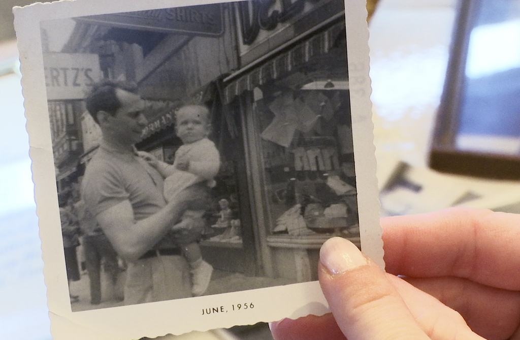 ADVANCE FOR USE MONDAY, JULY 31, 2017 AND THEREAFTER-In this Wednesday, June 7, 2017 image made from video, Denyse DeLuca holds a photo of her grandfa...
