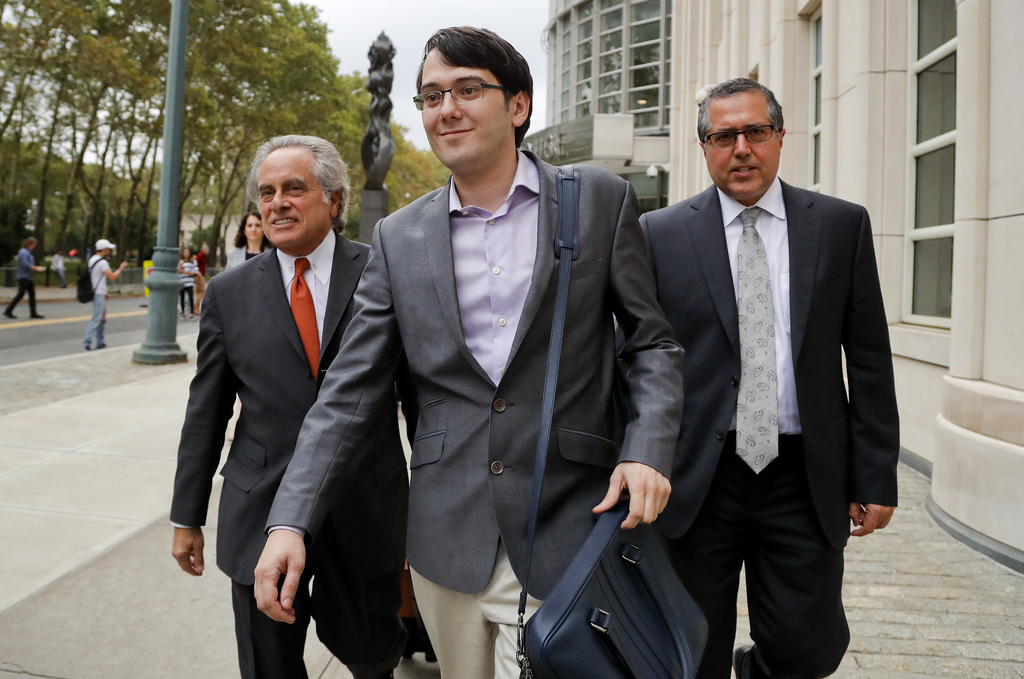 FILE - In this Thursday, July 27, 2017, file photo, former biotech CEO Martin Shkreli, center, leaves federal court with his attorney Benjamin Brafman...