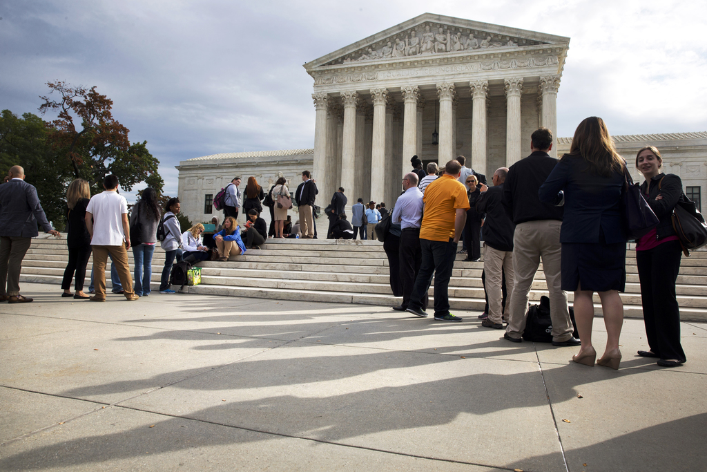 ADVANCE FOR USE MONDAY, JULY 31, 2017 AND THEREAFTER-FILE - In this Tuesday, Oct. 13, 2015 file photo, people line up outside of the Supreme Court in ...
