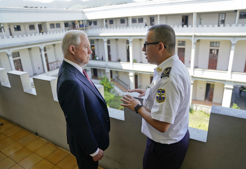 U.S. Attorney General Jeff Sessions listens to Howard Augusto Cotto Castaneda, Director General of the National Police during a visit to the National ...