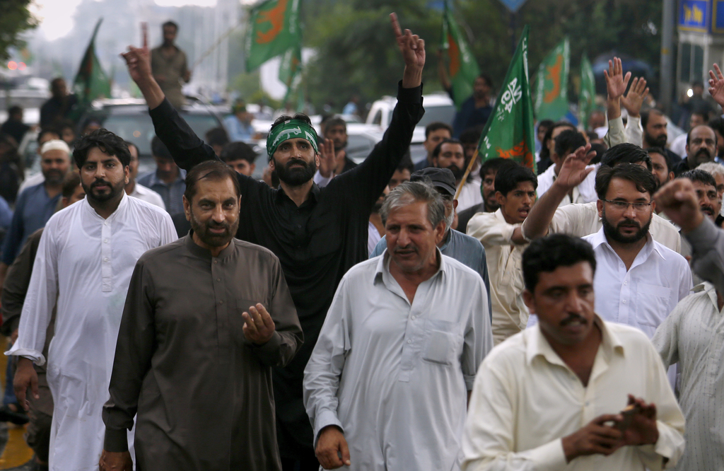 Supporters of Pakistan's deposed Prime Minister Nawaz Sharif take part in a rally to to condemn the dismissal of their leader, in Islamabad, Pakistan,...