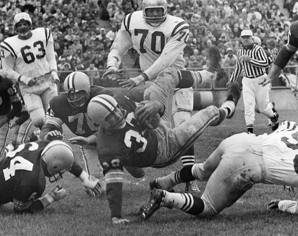 FILE - In this Oct. 11, 1959, file photo, Green Bay Packers halfback Lewis Carpenter (33) is upended by San Francisco 49ers Matt Hazeltine (55) in the...