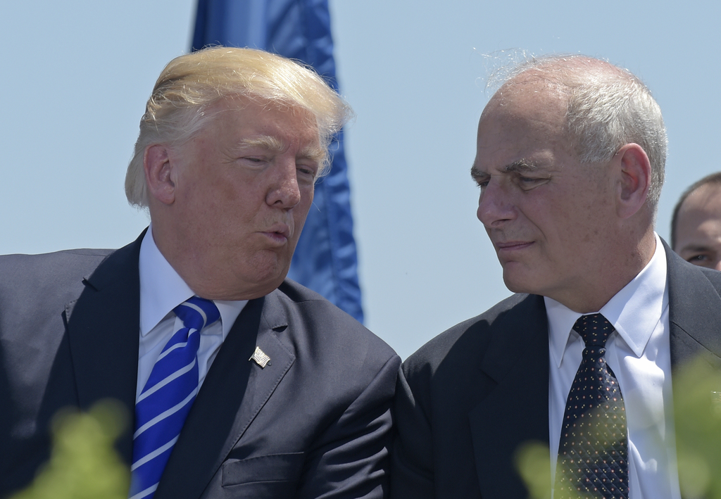 FILE - In this May 17, 2017, file photo, President Donald Trump talks with Homeland Security Secretary John Kelly during commencement exercises at the...
