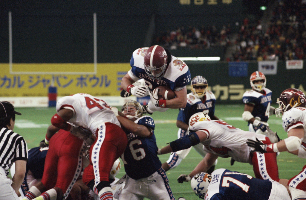 FILE - In this Jan. 12, 1992 file photo, East's Kevin Turner, of Alabama, dives over the top for a touchdown in the fourth quarter of the Japan Bowl, ...