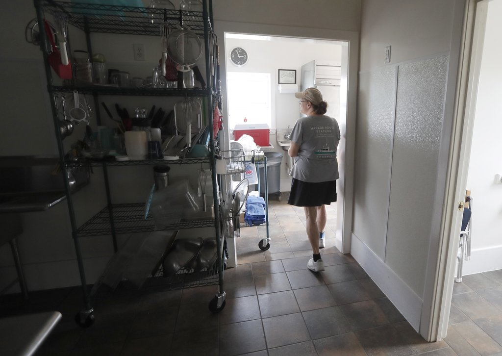 Vicki Harrison walks through Harbor House Seafood in Hatteras, N.C. Friday July, 28, 2017. Even though the power was out, Harbor House was open, keepi...